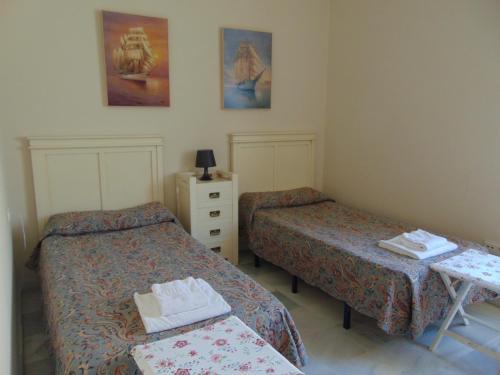 Una cama o camas en una habitación de Apartamentos Larga 70