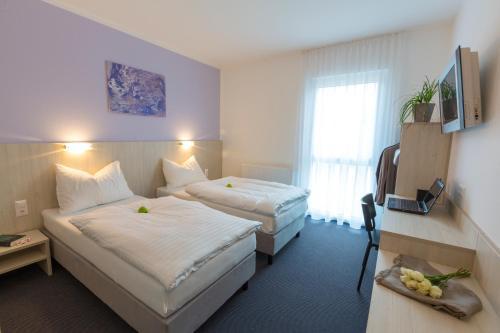 Фотографии отеля: Topmotel, Oberegging