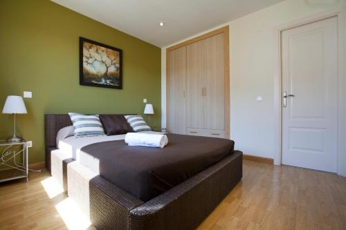 מיטה או מיטות בחדר ב-Apartamentos APR Alcalá