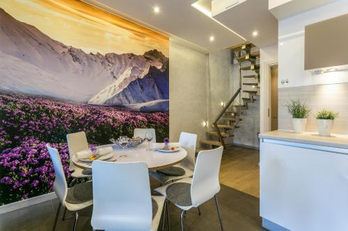 מסעדה או מקום אחר לאכול בו ב-VIP Apartamenty Stara Polana
