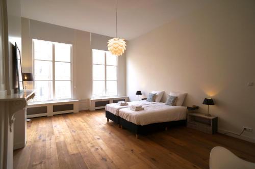Cama ou camas em um quarto em Stayci Serviced Apartments Luther Deluxe