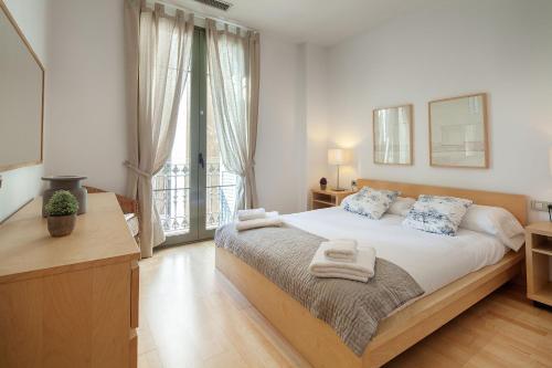 Giường trong phòng chung tại Habitat Apartments Alibei