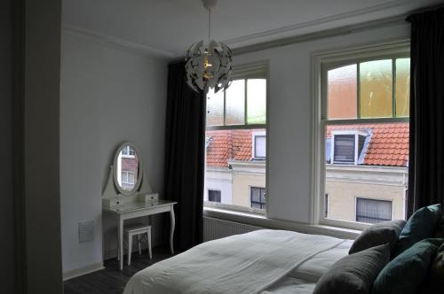 Cama ou camas em um quarto em Mallemolen