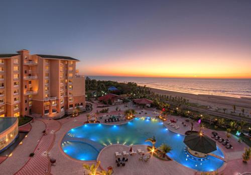 Фотографии отеля: Royal Tulip Sea Pearl Beach Resort & spa, Nidānia