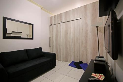 Uma área de estar em Copa´s Apartment
