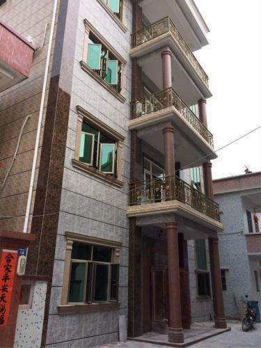 Hotel Pictures: Shuangyuewan Happy Inn, Huidong