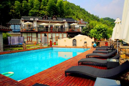 Hotel Pictures: Mountain Cat Inn, Deqing