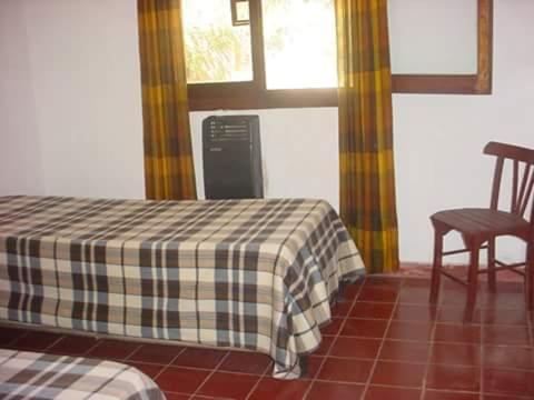 Una habitación de Casa Aguaribay