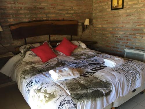 Una cama o camas en una habitación de El chalet de Alba
