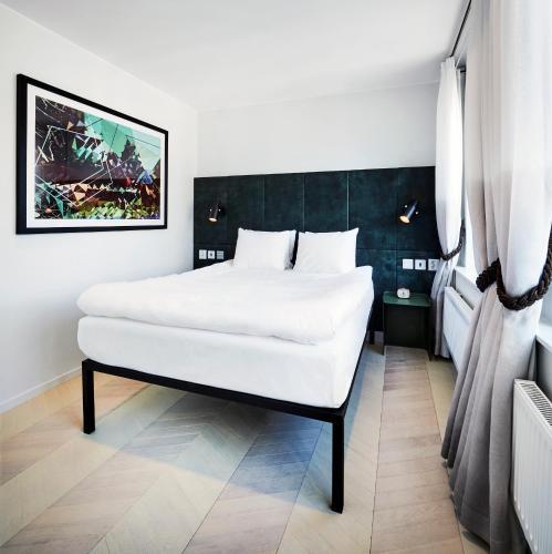 מיטה או מיטות בחדר ב-Generator Stockholm