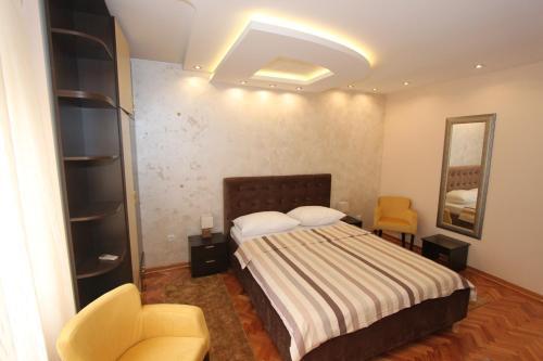 Una cama o camas en una habitación de Belgrade Downtown Apartments
