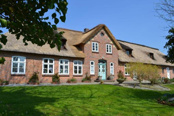 Hotelbilleder: Landhaus-Ole-Steen-Wohnung-Leuchtturm, Tating