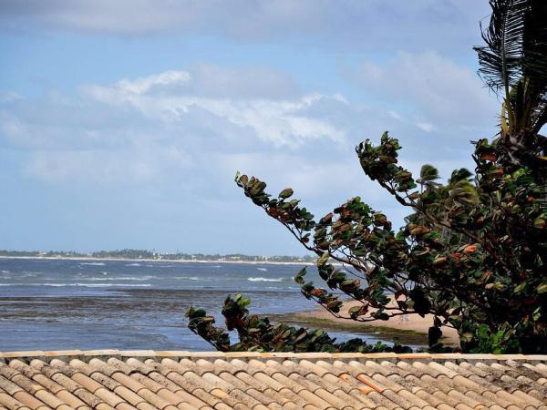 Hotel Pictures: apart novo em frente ao mar no centro da vila da praia do forte, Itapevi