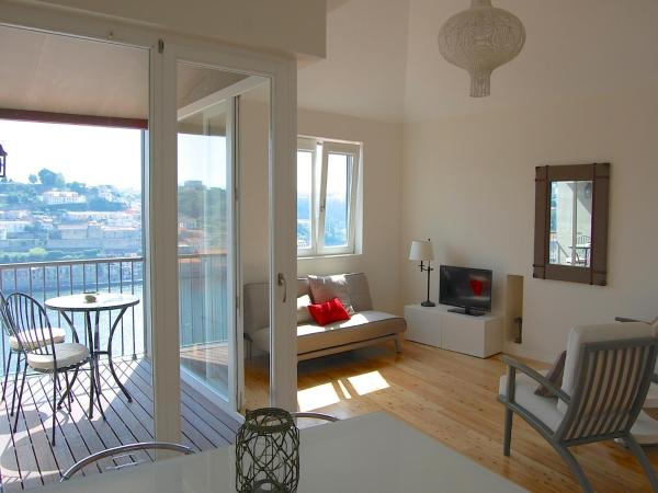 One-Bedroom Apartment with Balcony and River View