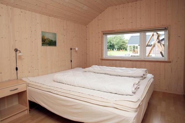 Hotelbilleder: Four-Bedroom Holiday home in Væggerløse 9, Bøtø