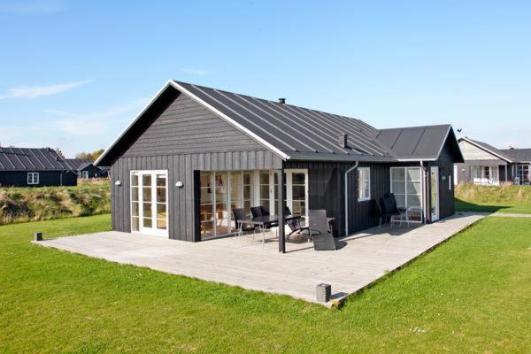 Hotel Pictures: Three-Bedroom Holiday home in Nysted 1, Nysted