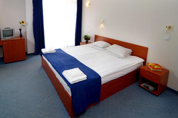 Double or Twin Room with Balcony and Partial Sea View (2 Adults + 1 Child)
