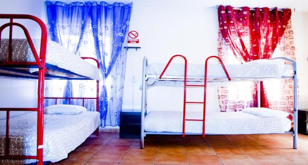 Bed in 8-Bed Female Dormitory Room with Bathroom