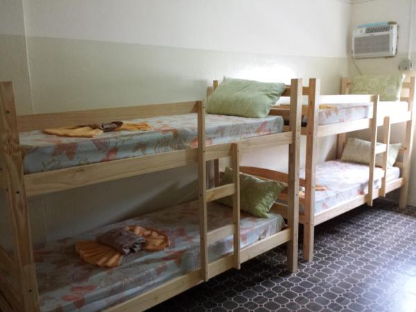 Bed in 8-Bed Male Dormitory Room with Fan