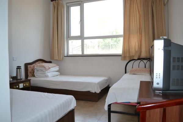 Hotel Pictures: Longqing Gorge Huanle Jiayuan Inn, Yanqing