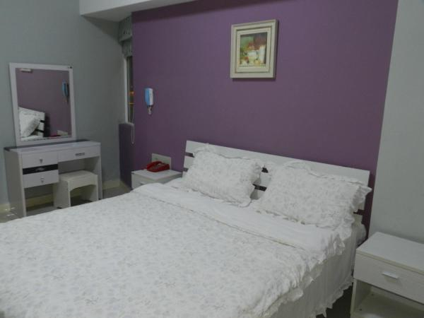 Hotel Pictures: Sunshine Apartment Hotel, Jinghong