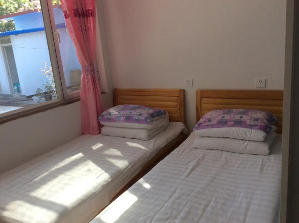 Hotel Pictures: Xingfu Xiaoyuan Homestay, Xinglong