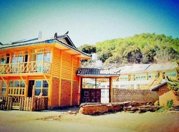 Hotel Pictures: Lugu Lake Caohu Huayang Inn, Yanyuan