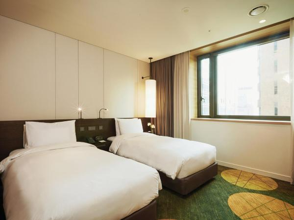 Deluxe Twin Room with Free Breakfast for 1 Person