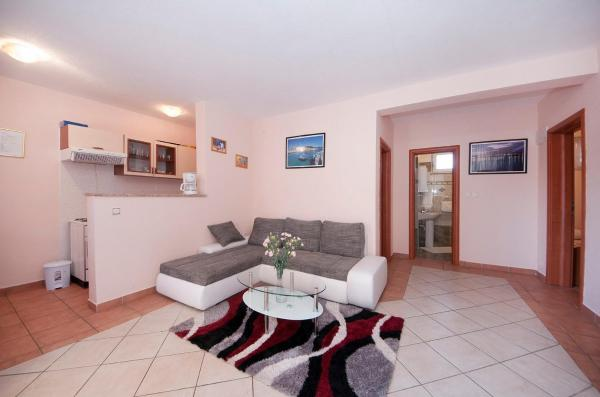 Three-Bedroom Apartment with Garden View