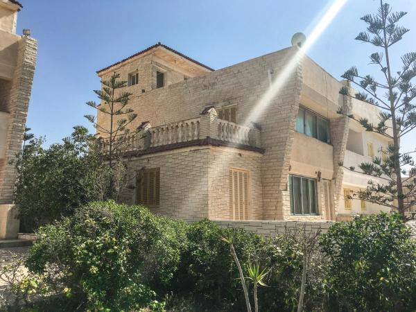 Hotel Pictures: Four-Bedroom Villa with Sea and Garden View at Togareen Village North Coast, Al Ḩammām