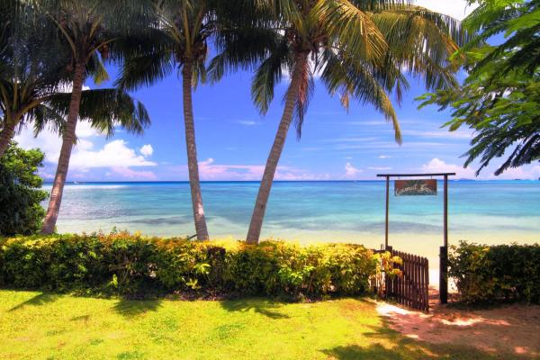 Hotel Pictures: Coconut Grove Beachfront Cottages, Matei
