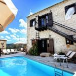 Hotel Pictures: Leonidas Village Houses, Goudhi