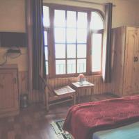 Hotellbilder: schanagzer lodge and cafe, Manāli