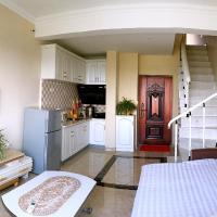 Hotel Pictures: 鲅鱼圈山海广场海之旅家庭旅馆, Yingkou