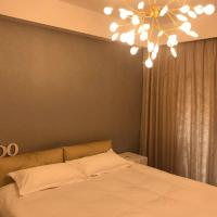 Hotel Pictures: Warm Two-bedroom Guest House Near East Railway Station, Lishui