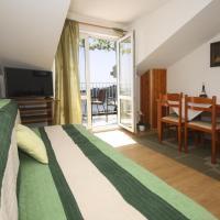 酒店图片: Apartment Mlini 15380d, 米利尼
