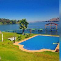 Фотографии отеля: Lago Rapel, casa amplia y cómoda a orilla de lago, Las Cabras
