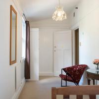 Modest Single Room with Shared Bathroom