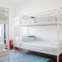 Bed in 4-Bed Dormitory Room with Balcony