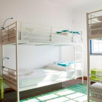 Bed in 4-Bed Dormitory Room with Sea View