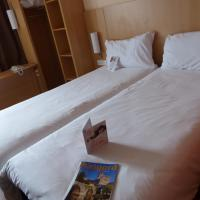Room with 1 Double and 1 Single Bed