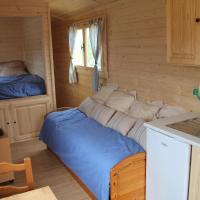 Wooden Caravan (2 Adults + 2 Children)
