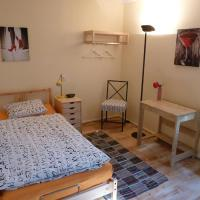 Single Room with Shared Bathroom and TV