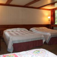Two Double Beds and Additional Twin Bed