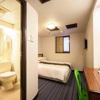 Standard Queen Room with smartphone