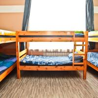 Bed in 10-Bed Dormitory Room with Shared Bathroom