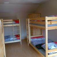 Top Bunk Bed in Male Dormitory Room