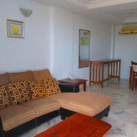 Three-Bedroom Apartment with Partial Sea View