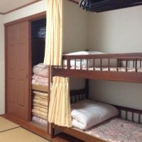 Room with Bunk Beds and Shared Bathroom