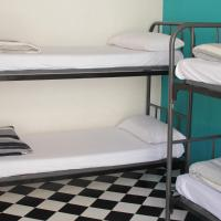 Bed in 4-Bed Dormitory Room with Shared Bathroom